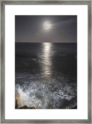 Crashing With The Moon Framed Print by Bryan Toro