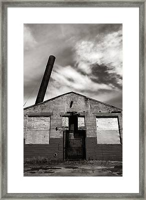 Crazy Old Building Framed Print by Jim Hughes
