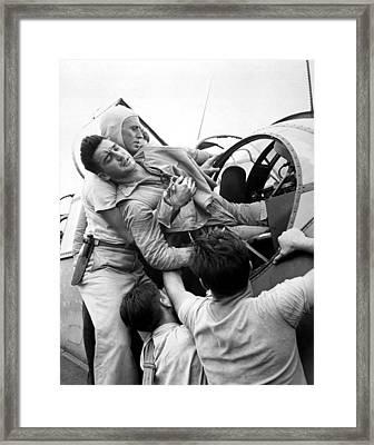 Crewmen Lift A Wounded Pilot Framed Print