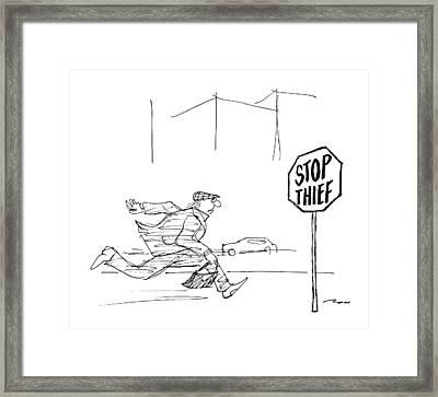 Criminal Runs Past Stop Sign Reading Stop Thief Framed Print