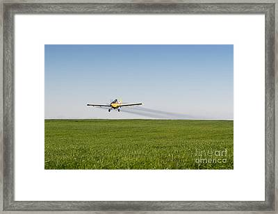 Crop Duster Airplane Flying Over Farmland Framed Print