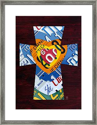 Cross With Heart Rustic License Plate Art On Dark Red Wood Framed Print by Design Turnpike