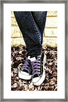 Crossed Feet Of Teen Girl Framed Print by Birgit Tyrrell