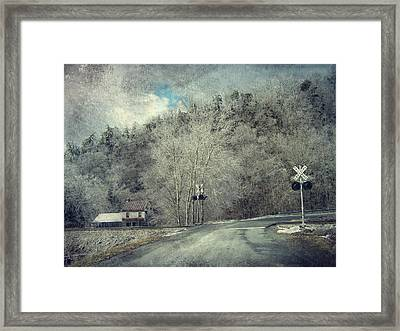 Crossing Into Winter Framed Print by Kathy Jennings