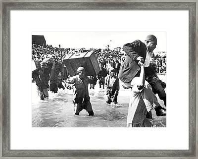 Crossing The River Framed Print by Munir Alawi