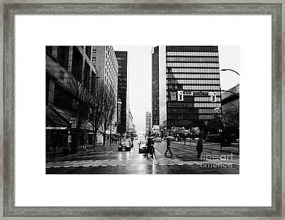 crosswalk at west georgia and hornby downtown in the rain Vancouver BC Canada Framed Print by Joe Fox