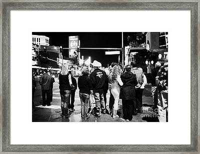 crowd of people standing waiting for crosswalk lights to change Las Vegas Nevada USA Framed Print