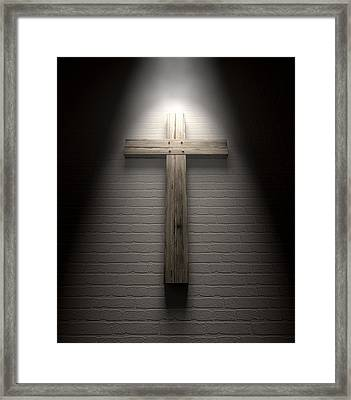 Crucifix On A Wall Under Spotlight Framed Print by Allan Swart