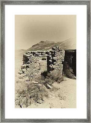 Crumbling Rock Wall With Door Framed Print