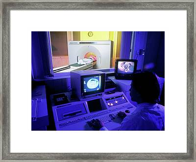 Ct Scan In Progress Framed Print by Simon Fraser/science Photo Library