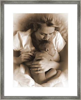 Cuddling With Mom Framed Print