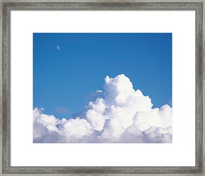 Cumulus Clouds And Moon In Sky Framed Print