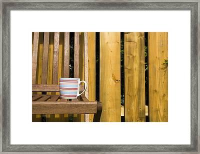 Cup On Garden Chair Framed Print