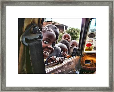 Curiosity Framed Print by Wallaroo Images