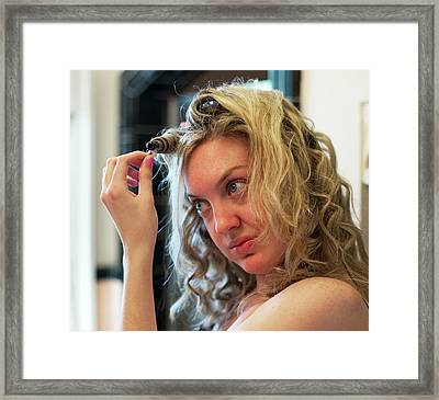 Curling Iron Use Framed Print by Jim West