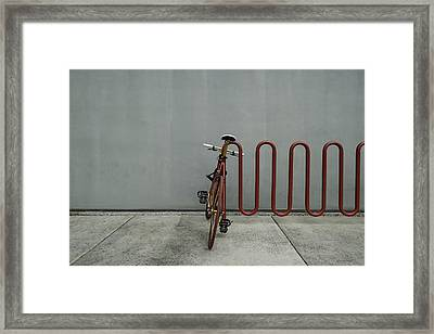 Framed Print featuring the photograph Curved Rack In Red - Urban Parking Stalls by Steven Milner