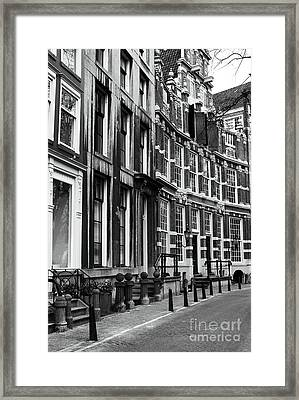 Curved Street Framed Print by John Rizzuto