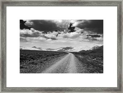 Curving Road Into The Mountains Framed Print by Eric Benjamin