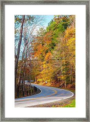 Curvy Autumn Road Framed Print by Kenneth Sponsler