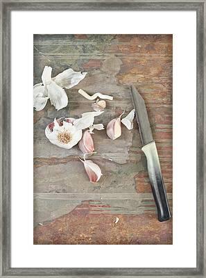 Cutting Garlic Framed Print