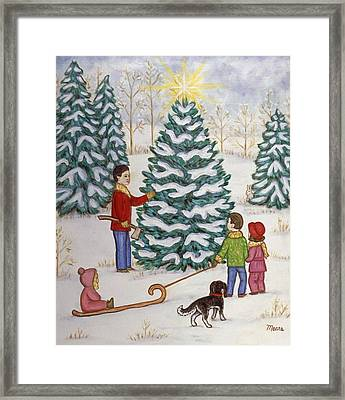 Cutting Our Tree Framed Print