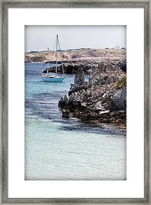 In Cala Pudent Menorca The Cutting Rocks In Contrast With Turquoise Sea Show Us An Awsome Place Framed Print