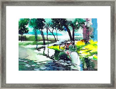 Cycle In The Puddle Framed Print by Anil Nene