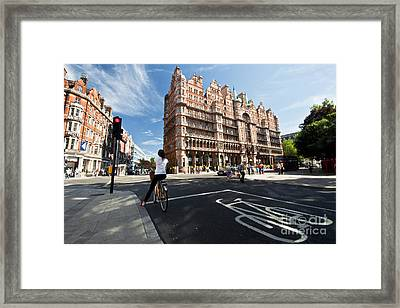 Cycling In Russell Square  Framed Print by Rob Hawkins