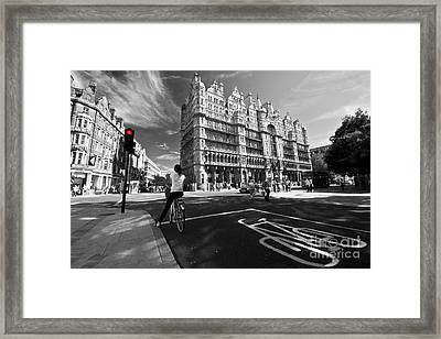 Cycling In The City Framed Print by Rob Hawkins