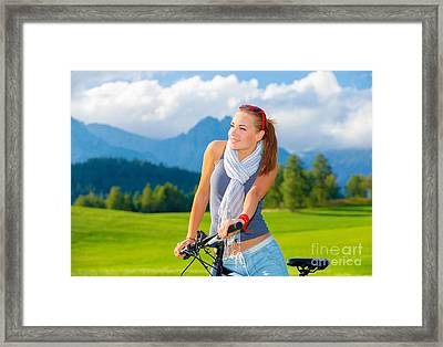 Cyclist Girl In Mountains Framed Print by Anna Om