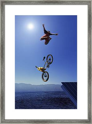 Cyclist Going Off Jump Into Water Framed Print