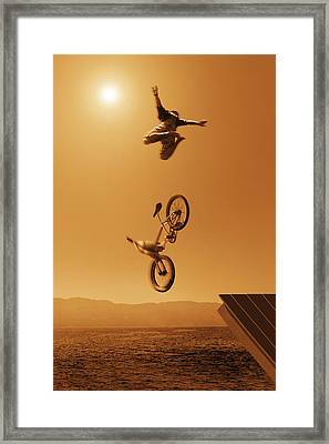 Cyclist Going Off Jump Into Water In Framed Print