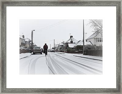 Cyclist In The Snow Framed Print by Tom Gowanlock