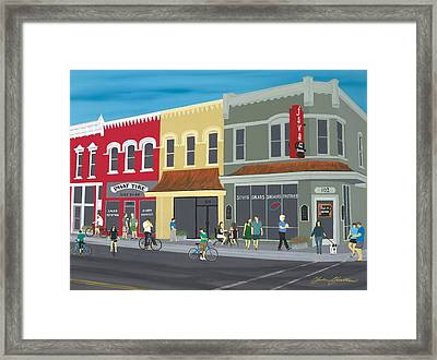 Cyclists On The Square Framed Print by Clinton Cheatham