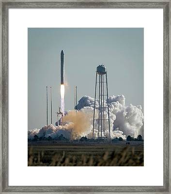 Cygnus Cargo Spacecraft Launch Framed Print by Nasa/bill Ingalls