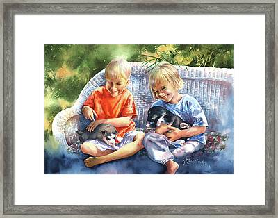 Dakotas Puppies Framed Print