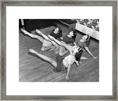Dancers Warmup Exercises Framed Print by Underwood Archives