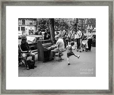 Dancing On A Paris Street Framed Print
