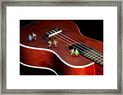 Dancing Party On A Guitar Framed Print