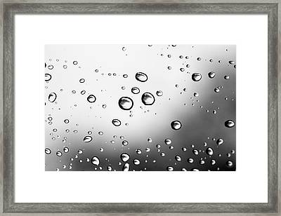 Dancing Raindrops Framed Print by Susan Stone
