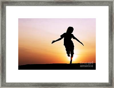 Dancing With The Sun Framed Print by Tim Gainey