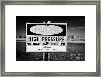 danger sign for high pressure natural gas pipeline underground bengough Saskatchewan Canada Framed Print by Joe Fox
