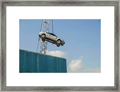 Dangling Car Framed Print