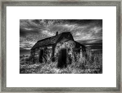 Dark Skies On The Prairie Framed Print by Dan Jurak