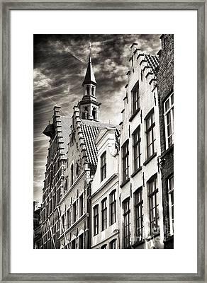 Dark Sky In Bruges Framed Print by John Rizzuto