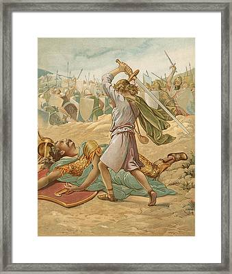 David About To Slay Goliath Framed Print by John Lawson