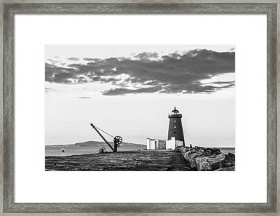 Davit And Lighthouse On A Breakwater Framed Print by Semmick Photo