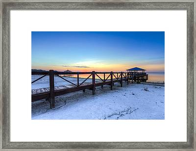 Dawn At The Dock Framed Print by Debra and Dave Vanderlaan