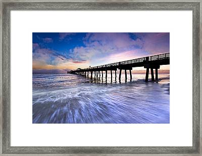 Dawn At The Juno Beach Pier Framed Print by Debra and Dave Vanderlaan