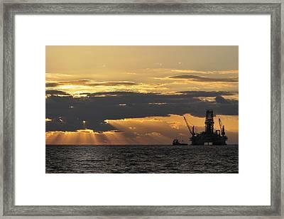 Dawn At The Oil Rig Framed Print by Bradford Martin